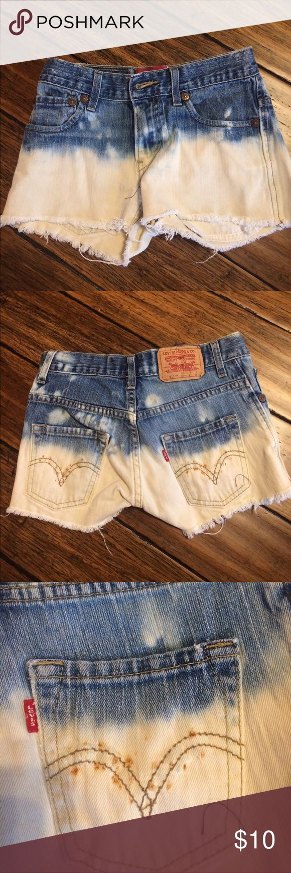 Distressed Cutoff Jean Shorts Cutoff shorts with bottom half bleached. Pockets had rivets that came out--some rusting on pockets. Levi's Shorts Jean Shorts