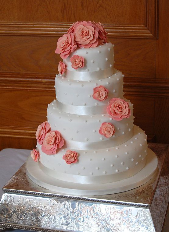 This satin and coral flowers wedding cake is so pretty