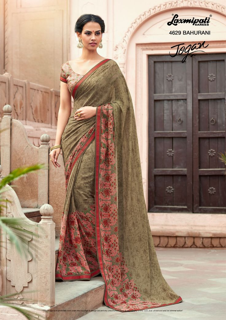 Mesmerize everyone with your wonderful conventional look by draping this Oak brown #georgette #floral #printed_saree along with Fancy Lace Border. Catalogue- JOGAN, Design Number: 4629, Price: ₹1375.00