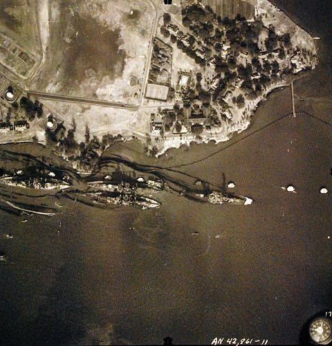 """Pearl Harbor Attack, 7 December 1941. Aerial view of """"Battleship Row"""" moorings on the southern side of Ford Island, 10 December 1941, showing damage from the Japanese raid three days earlier. http://wrhstol.com/29Wo6qN"""