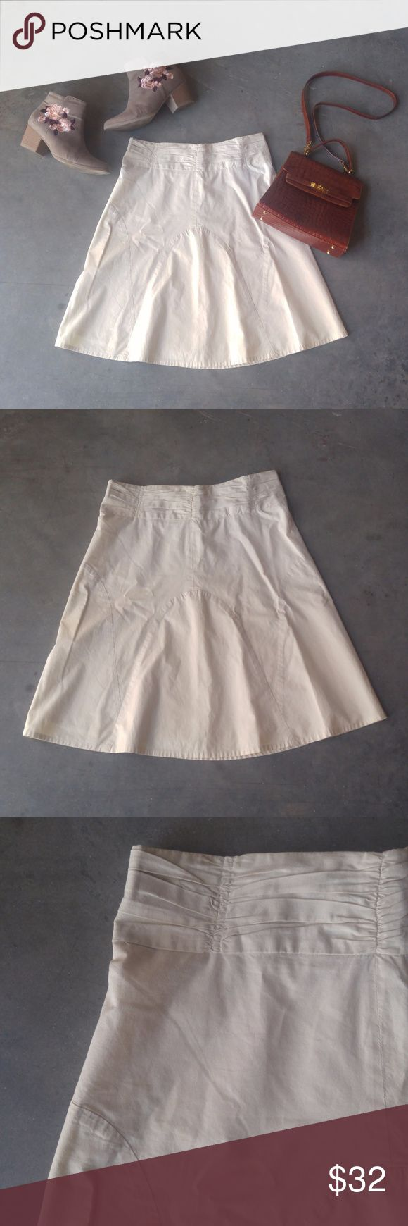 Odille Ivory A-Line Midi Skirt Odille brand skirt from Anthropologie, size 4 (small), in excellent condition! Full, a-line skirt with subtle round stitching. Khaki-like in an ivory/cream color. Side zip. No trades. No modeling. Make a reasonable offer. Thanks! *Cover photo accessories not included* Anthropologie Skirts Midi