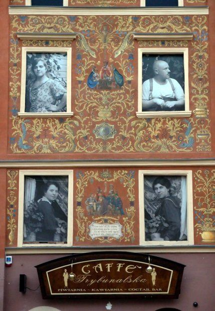 "Lublin, Poland. ""Project ""The City recommends..."" Installation of vintage photographs of Lublin Old Town residents in Rynek 4 currently renovated medieval house. March 2012"