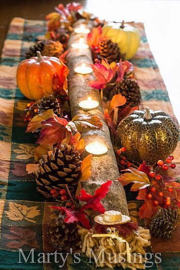 fall centerpiece from a holly tree and used as a centerpiece with tea candles.: