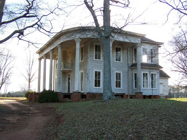 Abandoned Southern Mansion.  love the curves of the porch and the columns