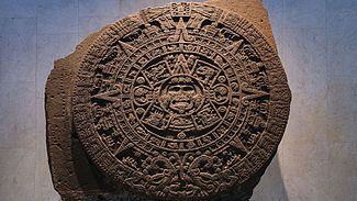 The Aztec calendar stone or Mexica Sun Stone is a large monolithic sculpture that was excavated in the Zócalo, the main square of Mexico City, on December 17, 1790. It was discovered while Mexico City Cathedral was being repaired. The stone is approximately 12 feet across and weighs approximately 24 tons. The exact purpose and meaning of the stone is unclear.