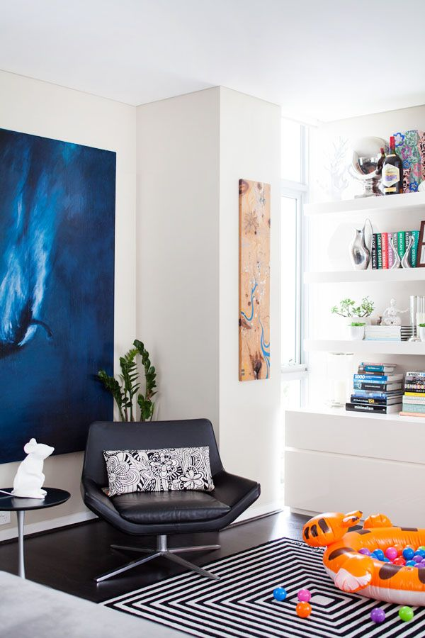 The Sydney home of interior designer Lorena Gaxiola and family.  Rug design by Verner Panton.  Artwork on left by American artist Josh Hassin, timber artwork on right by Jorge Tellaeche.  Photo – Phu Tang, Production – Lucy Feagins / The Design Files.