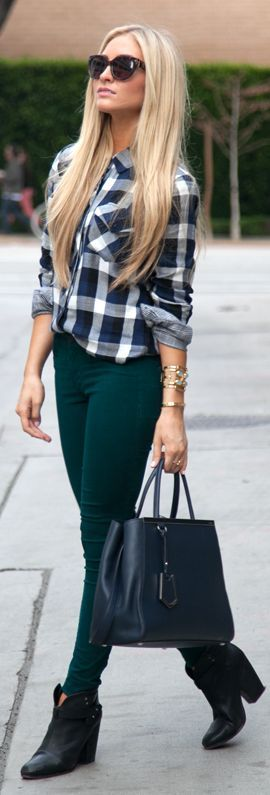 Even though she is wearing leggings as pants she looks nice with her flannel shirt buttoned to the top button.