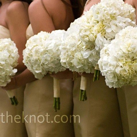 "For bridesmaids, consider bouquets of hydrangea. This big flower will pack a lot of ""OOMF"" with just a few stems. You can opt for white like the ones here, or add a little color!  Personally, I like the idea of going with all white for the bridesmaids and then adding a little bit of color to the bridal bouquet. Creates a beautiful pop against a white gown!"