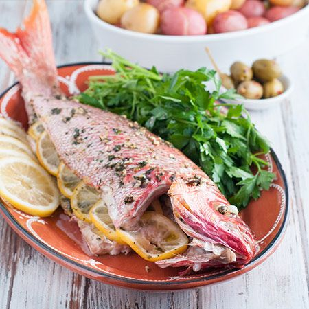 This whole baked red snapper recipe is delicious. It's baked with fresh ingredients inside, making it a tasty healthy choice for a quick weeknight dinner.