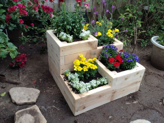How nifty is this handmade planter?? Would look adorable in a small yard. Love the levels.