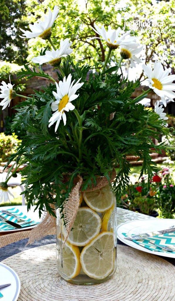 lemon and daisy centerpiece with burlap ribbon via My Sister's Bridal Shower - @Angela Gilbert Paris #bridalshower #burlap #lemons #daisy http://jugglingactmama.com/2014/05/sisters-bridal-shower.html