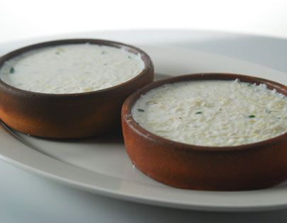 Set Curd Rice Recipe - Leftover rice mixed with milk, onion, green chillies, salt and curd and allowed to set.