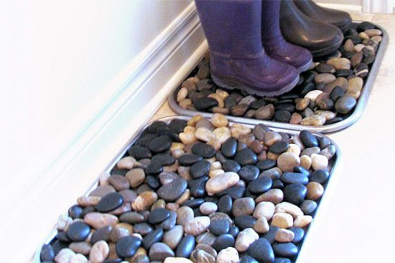 Puddle-Proof Boot Trays  You can keep melting slush and drippy rainwater off your entry flooring with a boot tray (or two). These are made from thrift store serving trays ($2 for 2 trays) and filled with tumbled craft store river rocks ($7 for 25 lbs.). Water drips into the trays — not your flooring. Occasionally, rinse off the rocks and trays outside with a garden hose, let dry, and re-install.