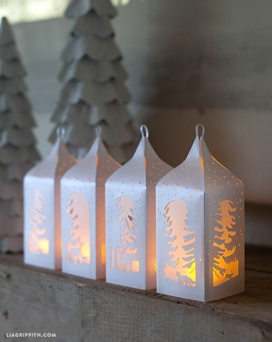 I love how these pretty woodland paper lanterns look on my mantel and will often light them in the early evening to enjoy through dinner.  #papercraft #diyholiday #paperart