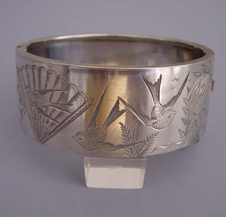 Victorian 1890s sterling bangle with etched birds and fan.