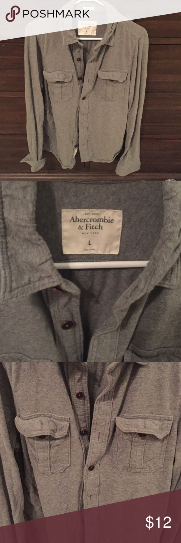 Abercrombie and Fitch Mens gray button down Gray tshirt cotton button down Abercrombie and Fitch 2 front pockets; brown buttons Abercrombie & Fitch Shirts Casual Button Down Shirts