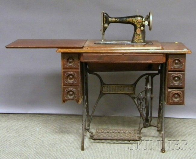 Singer Victorian Treadle-powered Sewing Machine with Walnut Cabinet.