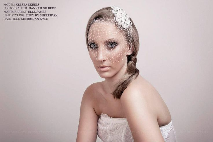 Stunning birdcage veil available to purchase in store.