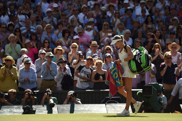 Eugenie Bouchard walks off Centre Court after her match - Florian Eisele/AELTC