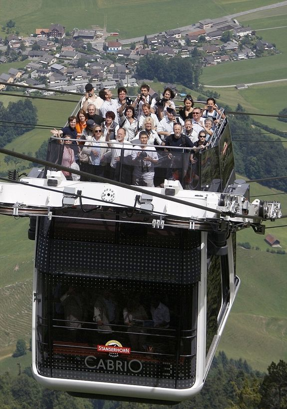The CabriO is the world's first roofless double decker aerial cable car. It climbs the Stanserhorn in Switzerland