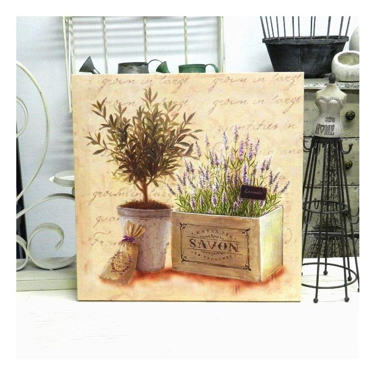 Obrazek z typowym dla stylu prowansalskiego motywem roślin w naczyniach, a także delikatnymi napisami na jasnym tle. Dodadzą, świeżości i delikatności w niejednym pomieszczeniu.