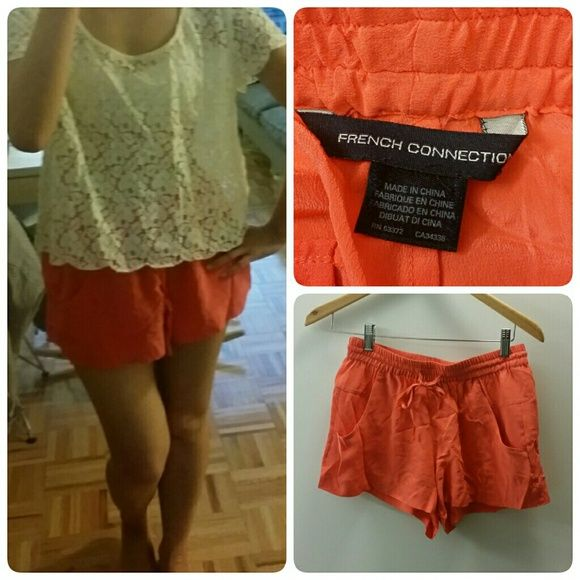 French connection 100% silk shorts Xs Bright coral silk shorts Elastic waist In very good condition Fit Xs  No trade. Selling only French Connection Shorts