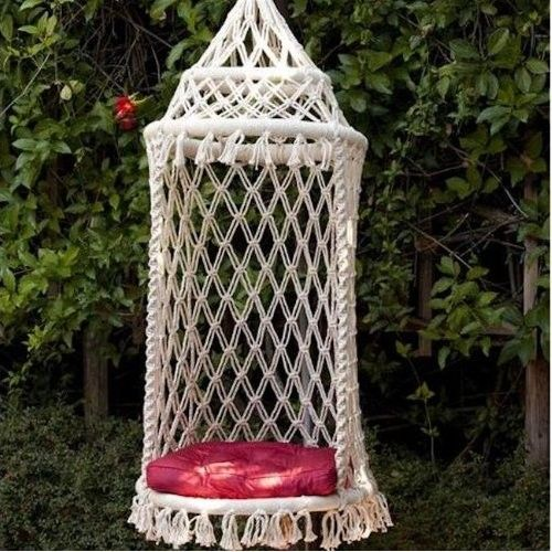 Swinging Macrame Birdcage chair - pretty sure I can do this one if I can find something sturdy for hoops - wonder if bicycle rim would be big enuff :S