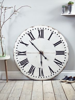 lightweight metal wall clock with a rustic industrial finish, our distressed oversized clock features painted black roman numerals and metal hands. Surprisingly lightweight and easy to hang, this larger than life industrial inspired aged metal clock will create a centrepiece in your kitchen or dining area.
