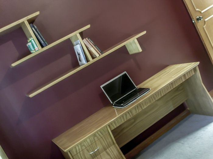 Custom Made Study Desk and floating shelves, made from pine with a slight tint added to the finish to make the grain pop