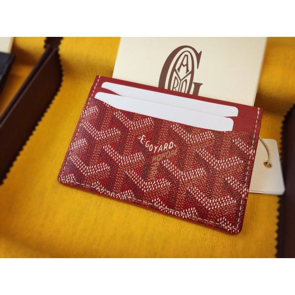 Goyard card holder in the wine/fuchsia color