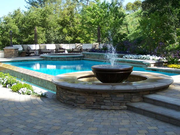 Enjoy your swimming pool right from the patio with a variety of water features. Check out these fountains, waterfalls and swim-up bars for some outdoor design ideas and inspiration.