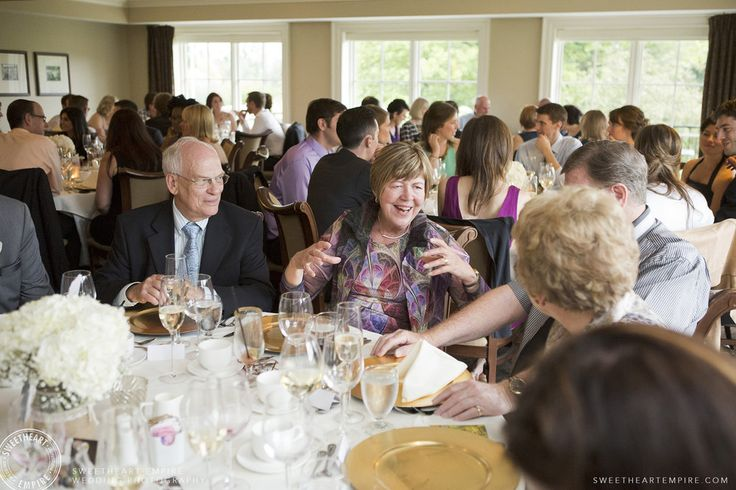 Wedding guests enjoying themselves at the Oakville Golf Club. Oakville wedding photographer #sweetheartempirephotography