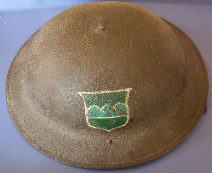 WWI helmet with the 80th Division insignia.