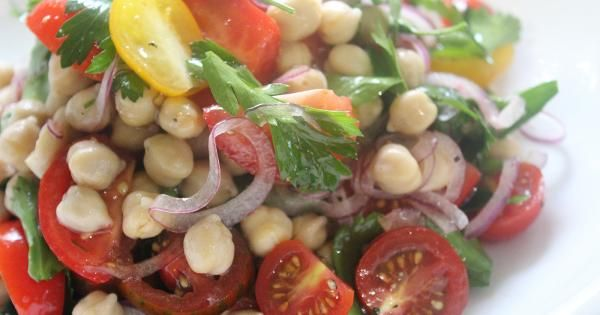 Tomato Chickpea Salad We can never have enough of pretty and colourful summery recipes to go with our lunch and dinner meals - especially when they are Matt's!