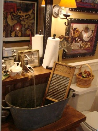 FARMHOUSE – INTERIOR – early american decor inside this vintage farmhouse seems perfect with a prim bathroom sink.