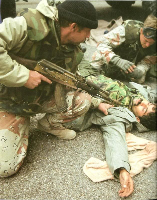 U.S. Special Forces detaining Iraqi soldier in Kuwait City, late February 1991