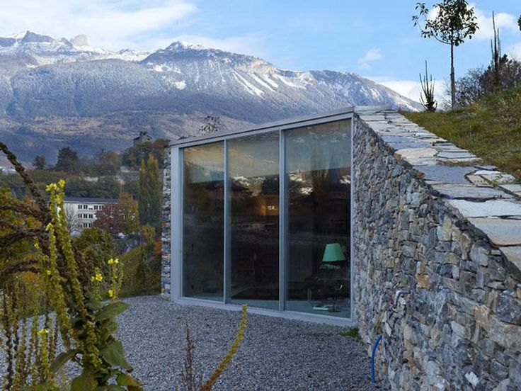 Underground Homes   In Sierra Switzerland   Glass And Stone Frontage, Then  Buried In The Hillside, With Grass Over Roof. Awesome Design