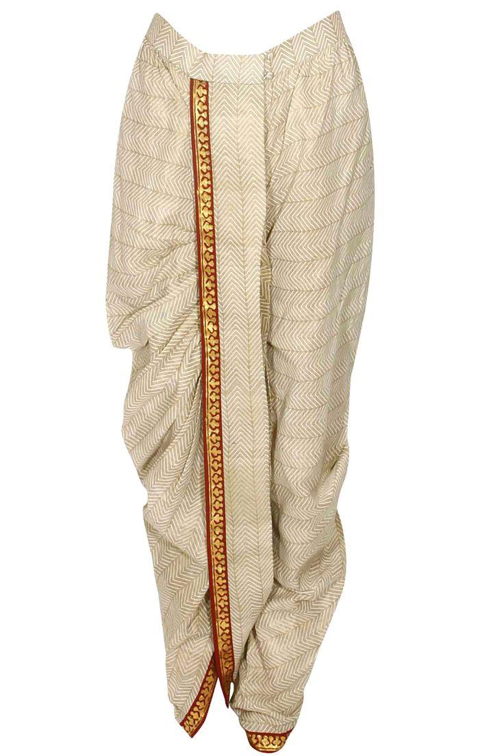 Ivory zig zag block print draped dhoti pants available only at Pernia's Pop Up Shop.#fashion #HappyShopping #love #shopnow #anjumodi#festive #new #perniaspopupshop