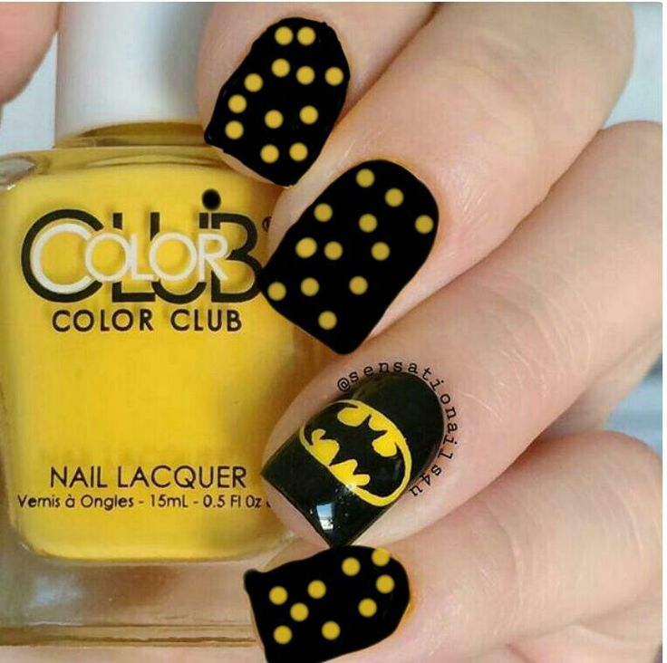 Batman nails, {the black with yellow polka dots looks like someone used Microsoft paint to put that on the nails?}