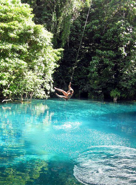 Swimming at one of Vanuatu's famous 'blue holes', Mavutor River, Espirito Santo Island (by Roderick Eime). I wouldn't mind beeing there right now…