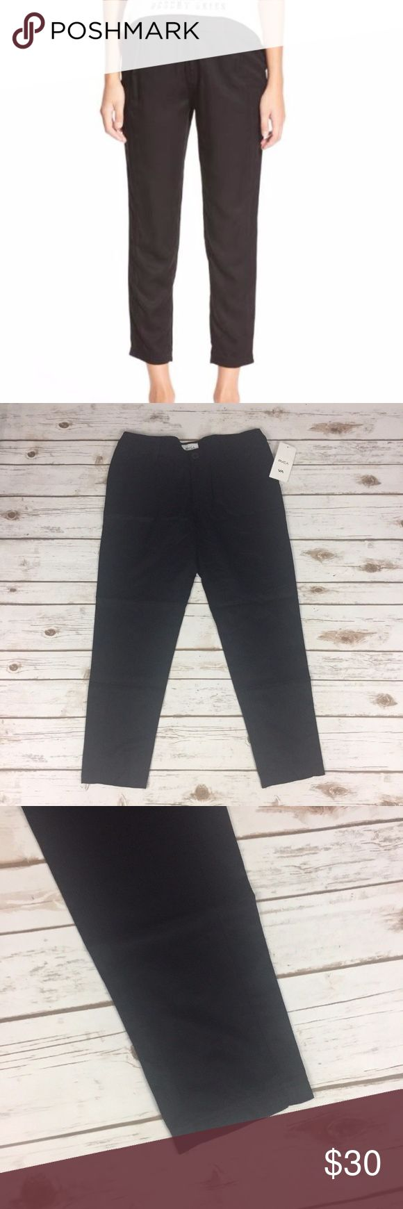 RVCA Size 26 Black Lowlands Crop Pants Skinny NWT RVCA Lowland Cropped Pants Black - Skinny Leg Women's Size 26   New with tags - MSRP $58.00 100% Rayon  A relaxed fit and ankle-grazing length play up the laid-back attitude of these comfy woven pants. Front button closure. Front slant pockets; back patch pocket  Measurements (in inches): Waist (side to side) - 15.5 Inseam - 25.5 Rise - 9 RVCA Pants Ankle & Cropped