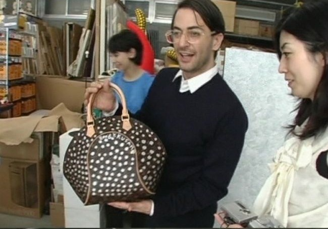 a collab in the making.  Marc Jacobs with a customized Yayoi Kusama LV bag in 2006