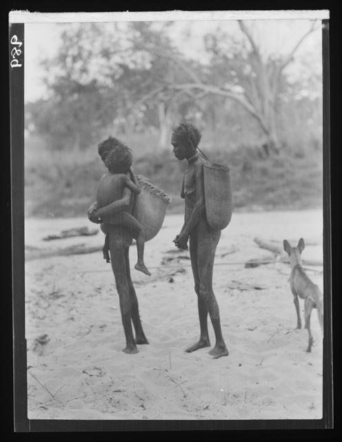 Australian Aboriginal women carrying plaited baskets.