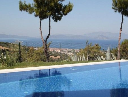 This excellent surrounded with palm trees for sale villa is located on kusadasi sogucak village.