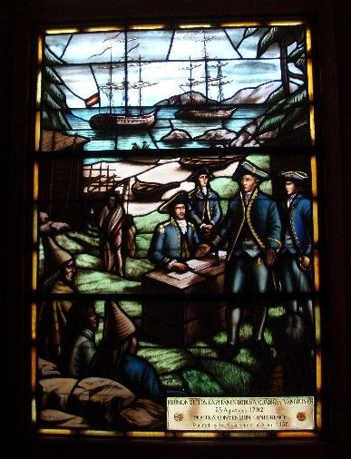 Nootka Island Stained Glass window of 1792 meeting between Captains Vancouver and Botega y Quadra with Chief Maquina looking on.