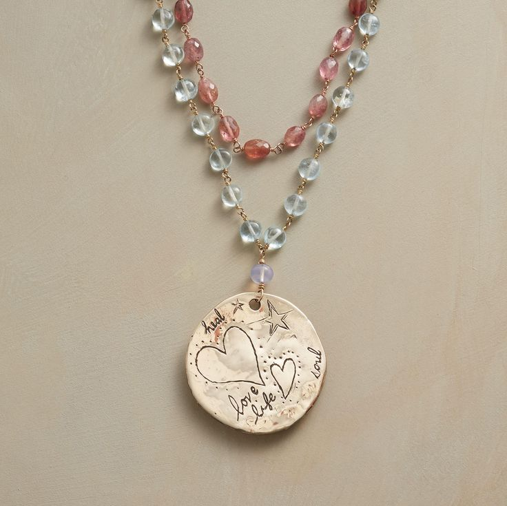 LOVING MOMENTS NECKLACE--Jes MaHarry suspends a medallion filled with loving sentiments from her necklace of rose quartz, pink tourmaline, aquamarine and a single lilac chalcedony stone. A Sundance exclusive in 14kt gold