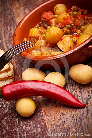 International Cuisine - Romanian Recipes - Country stew with vegetables and pork chops.