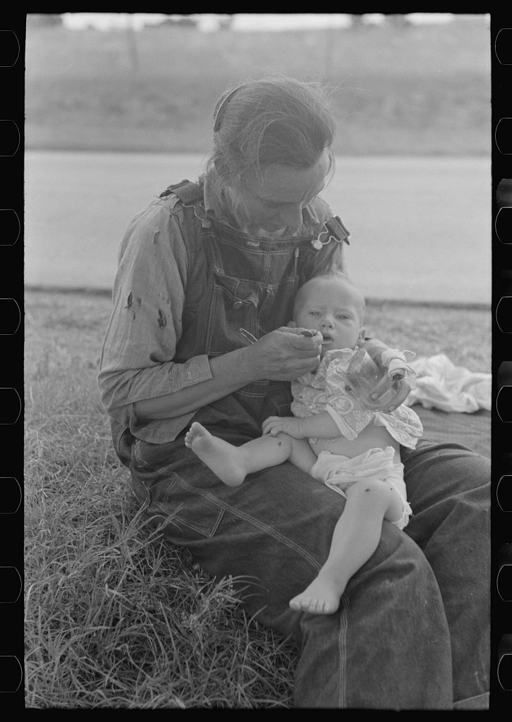 [Untitled photo, possibly related to: Migrant mother feeding her baby while the family was stopped by the roadside for lunch, east of Fort Gibson, Muskogee County, Oklahoma]   Library of Congress