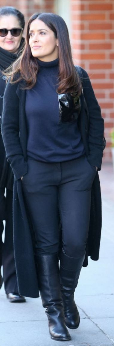 Who made  Salma Hayek's blue turtleneck sweater?