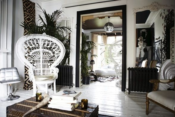 Glam London townhouse....love the giant wicker chair and very necessary disco ball.